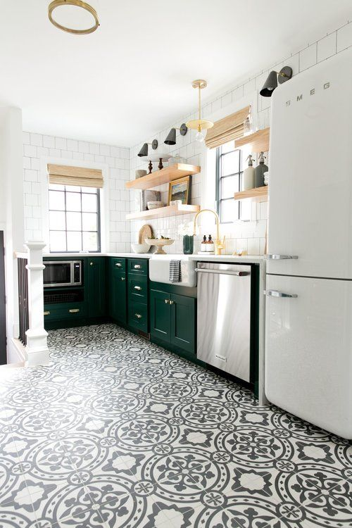 Modern Vintage Kitchen with cabinets in Benjamin Moore's Forest Green, open shelving, and cement tile.