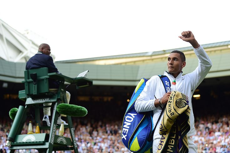 Nick Kyrgios raises his arm as he leaves Centre Court - Day 8