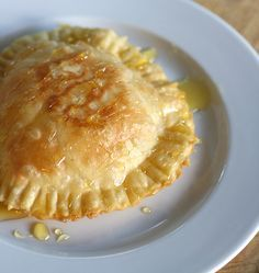 Sardinian Traditional Dessert: Seadas filled with fresh cheese and covered with honey