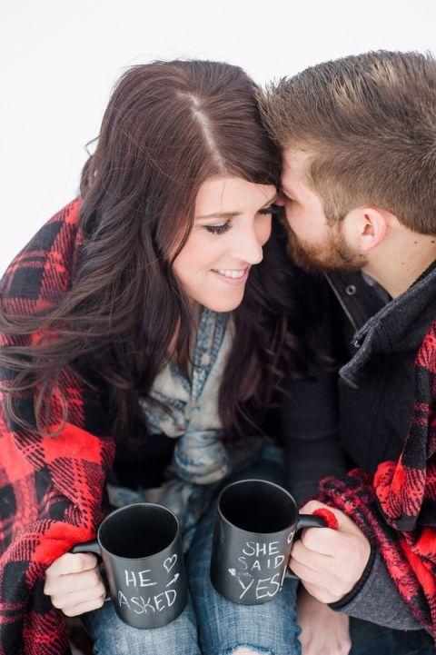 Snuggled Under a Buffalo Plaid Blanket   Imago Dei Photography   Warm and Cozy Snowfall Engagement Portraits