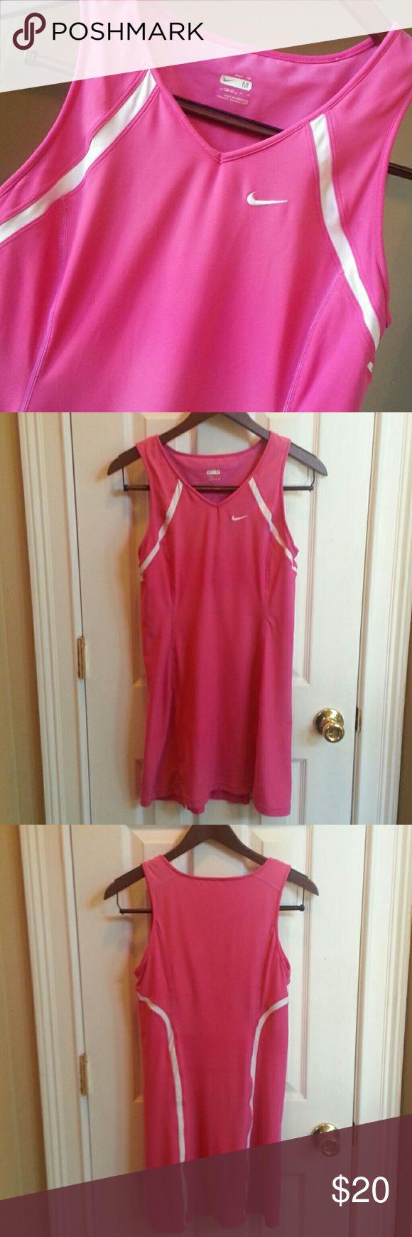 Nike Dress Nike hot pink tennis dress. Polyester and spandex blend. Shelf bra. Nike Dresses