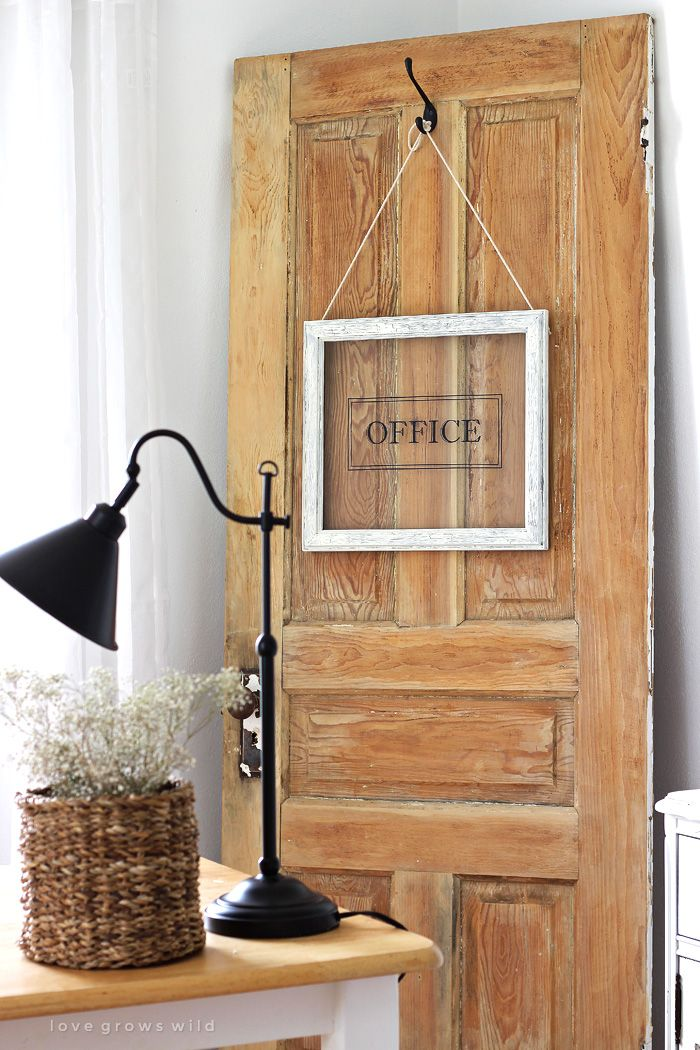 Old Door and Office Sign -Turn any picture frame into a hanging sign! Click to see more photos of this gorgeous farmhouse office decorated with an old door.
