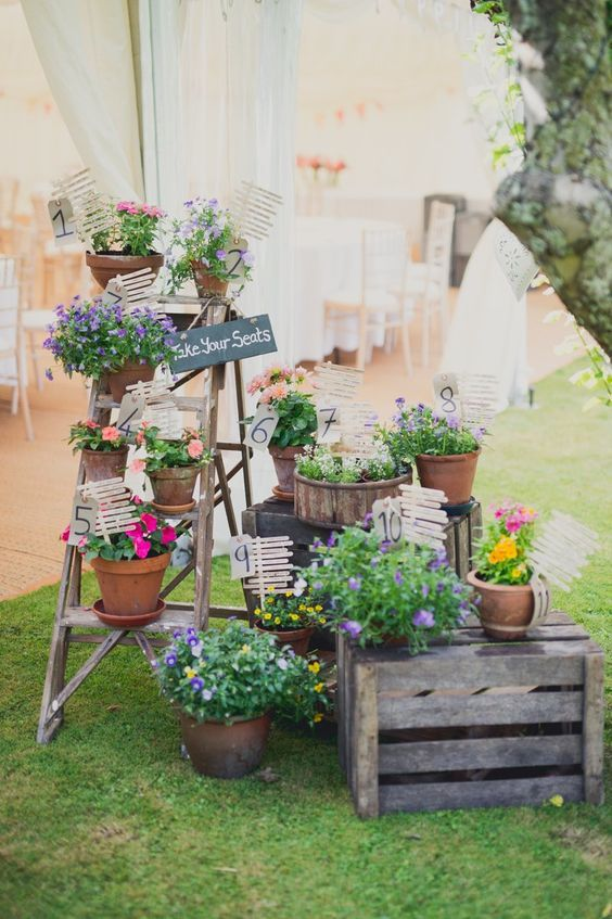 rustic country potted plants wedding seating decor idea / http://www.himisspuff.com/potted-plants-wedding-decor-ideas/