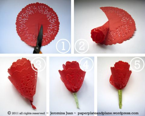 1. Take an 8″ red paper doily and cut a straight line to the center.  2. Roll the doily, making sure the wrong side faces up.  3. Twist the end.  4. You may use floral tape to create a stem, but I used what I found at home — green painter's tape.  5. Optional: you can cover the stem with ribbon for a more polished look.