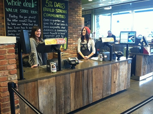 Reclaimed oak brown and gray board counter facing in Whole Foods in Franklin, TN.