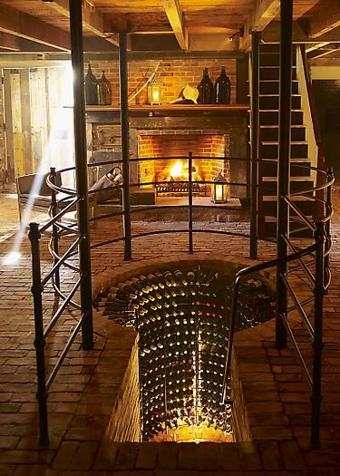 A gorgeous and intense entrance for a wine cellar. Beautiful!