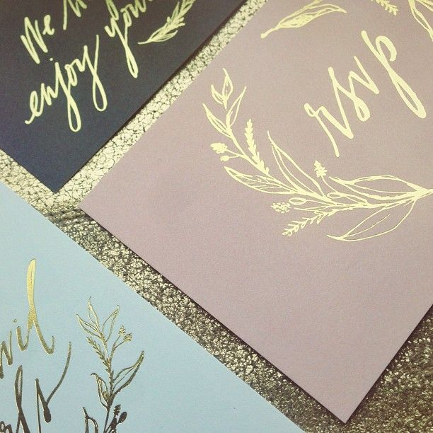 gold foil on light blue or warm mauve-ish gray.  who knew i'd like a pinkish color?  kinda my FAVORITE for it's faded quality.