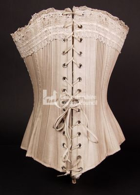Corset with hand stitched detail, 1885: Back view