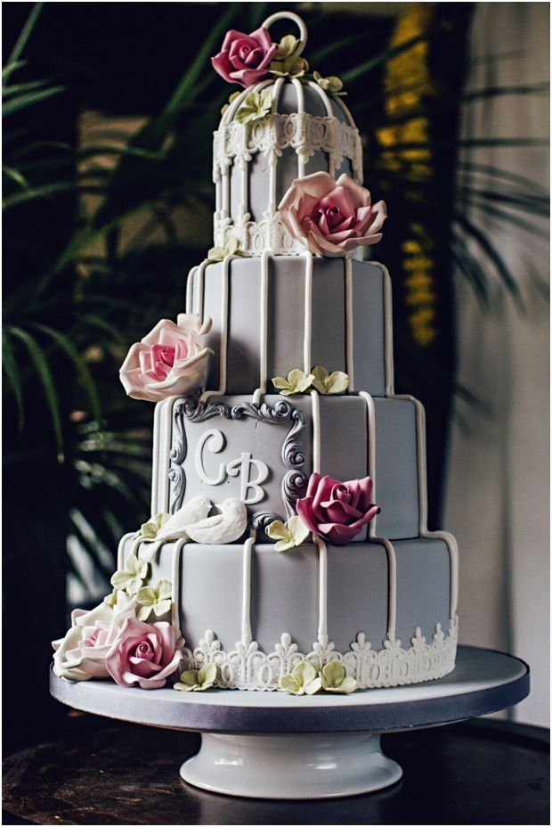 Wedding cake with flowers and the couple's initials by Ben The Cake Man. Click to see many more amazing wedding cakes and wedding cake ideas with modern themes such as woodland, tattoo, Alice In Wonderland, Star Wars, New York and more. Some would suit a