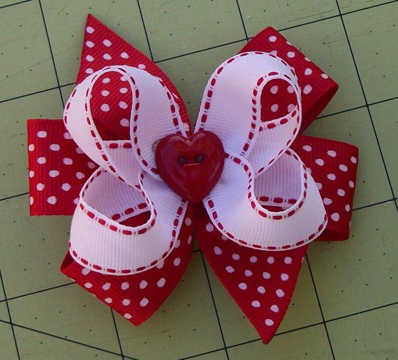 Make a pinwheel bow and 5/8 inch bow on top