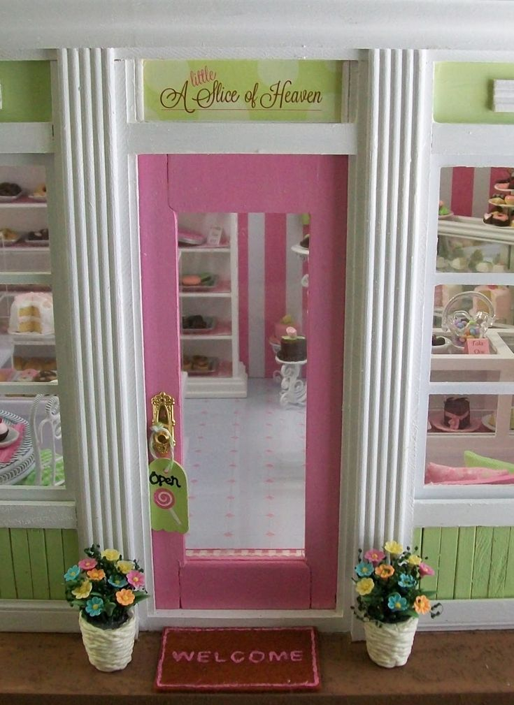 If I openned a bakery,  it would have character like this shoppe!  Pink & Green Bakery....pretty and inviting!