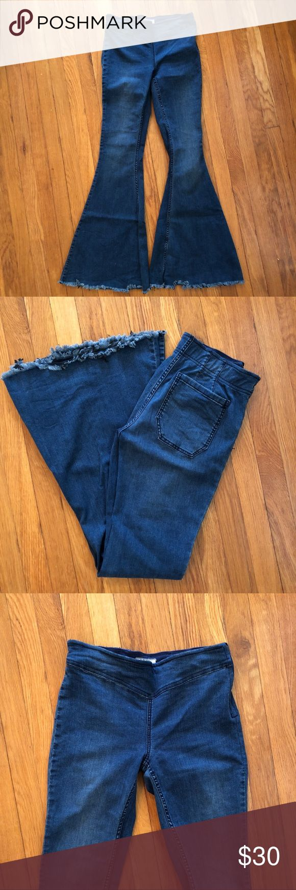Free People Super Flare Jeans Medium wash, mid-rise super flared jeans. Side zipper and raw hem. Great condition, only worn a few times. Free People Jeans Flare & Wide Leg