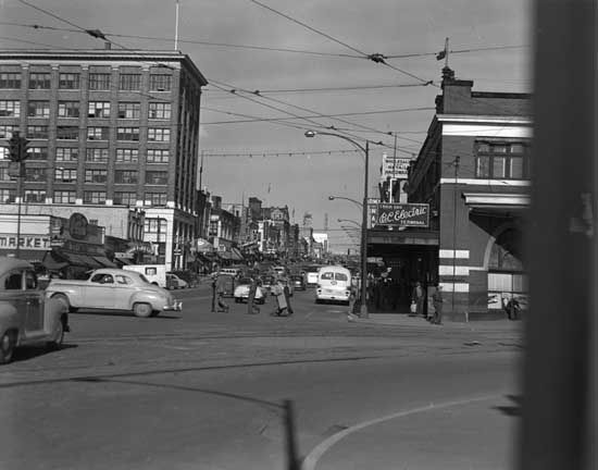 Photograph shows a view of Columbia Street looking east over Eighth Street.  [between 1949 and 1954]  IHP9267-0217