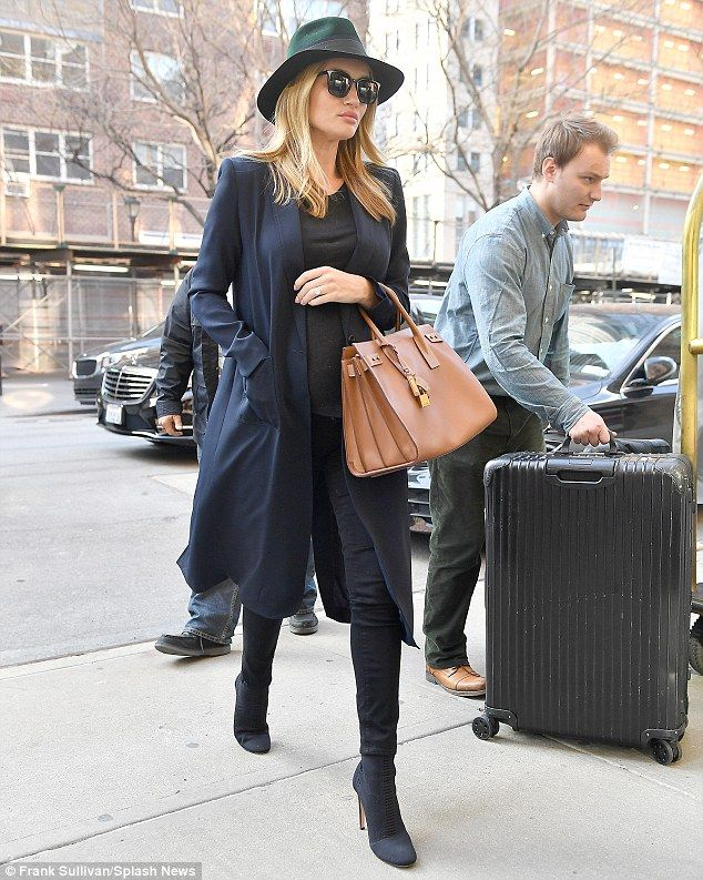 Under wraps: Rosie Huntington-Whiteley, 29, made sure to hide her blossoming baby bump as she stepped out in New York on Tuesday