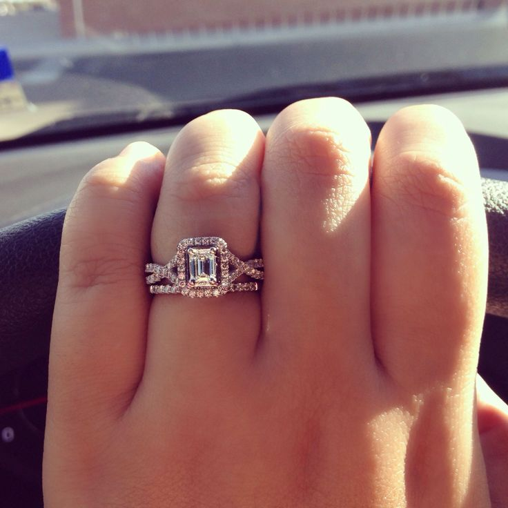 White gold split shank pavé emerald cut halo engagement ring & simple pavé white gold diamond wedding band.