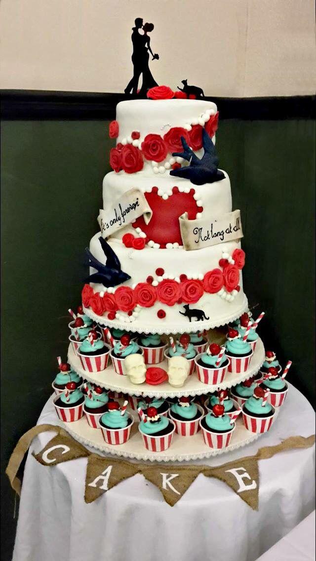 Tattoo inspired swallows on this #rocknroll #rockabilly #wedding #cake.