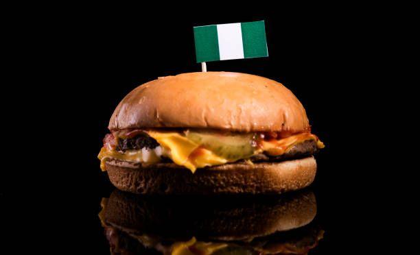 nigerian flag on top of hamburger isolated on black background