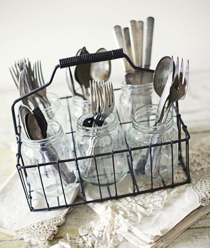 Place silverware in a mason jar and then a silverware holder