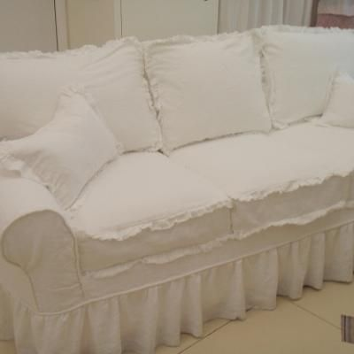 I love the look of this freyed sofa slipcover with wooden buttons on the back