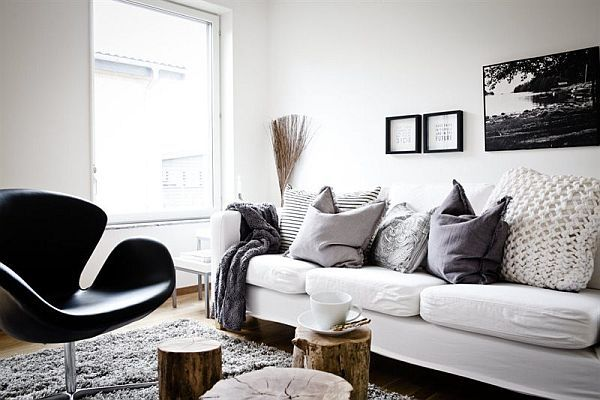 Love the feel of this, not the colors. Sofa that you want to dive into. Swan chair = awesome lines = art. Cozy texture in the rug, natural elements in the coffee table. yum. Would prefer less heavy sofa and table probably. and something more interesting on the walls