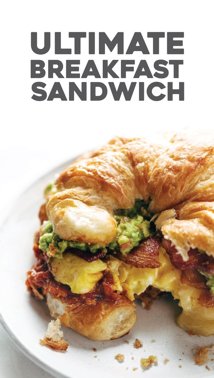 The Ultimate Breakfast Sandwich with eggs, bacon, guacamole, chunky tomato sauce, pepper jack cheese, all on a toasted croissant.  Favorite ever. | pinchofyum.com