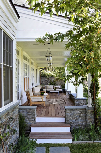 For a porch with a view, be careful not to impede the sight line by hanging your lanterns too low. In general, make sure you leave at least 7 feet from the porch floor to the bottom of the lantern. That way, even the tallest guests can enjoy the view.