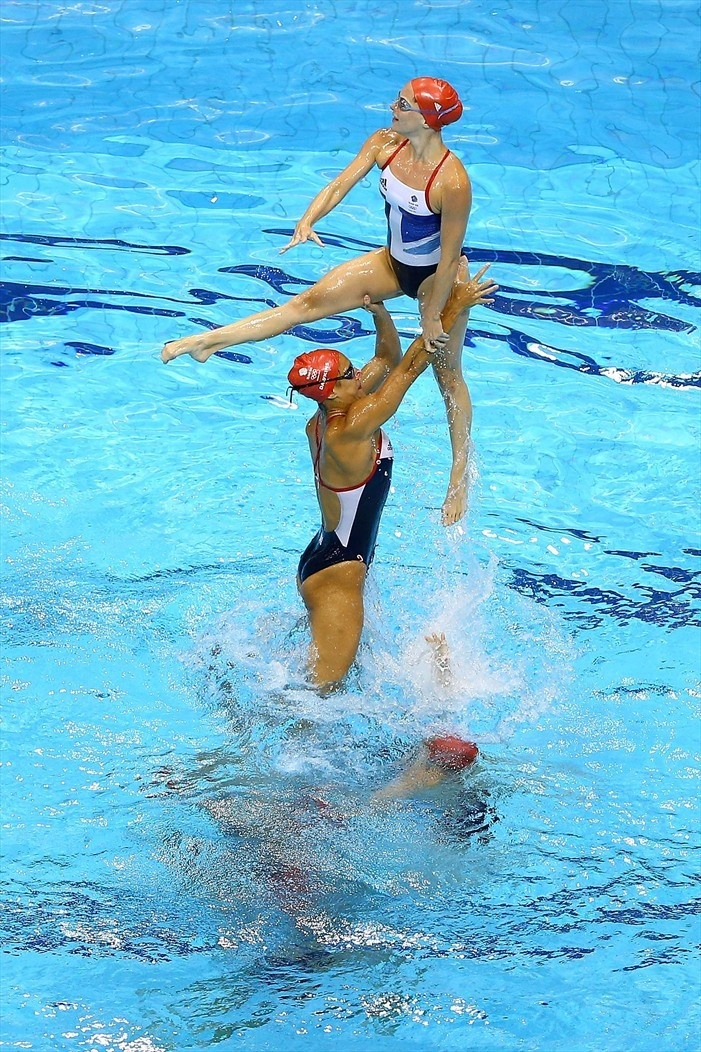 I don't think people realize how hard synchronized swimming really is.  Even as a swimmer, I couldn't ever come close to doing the things they manage to do.