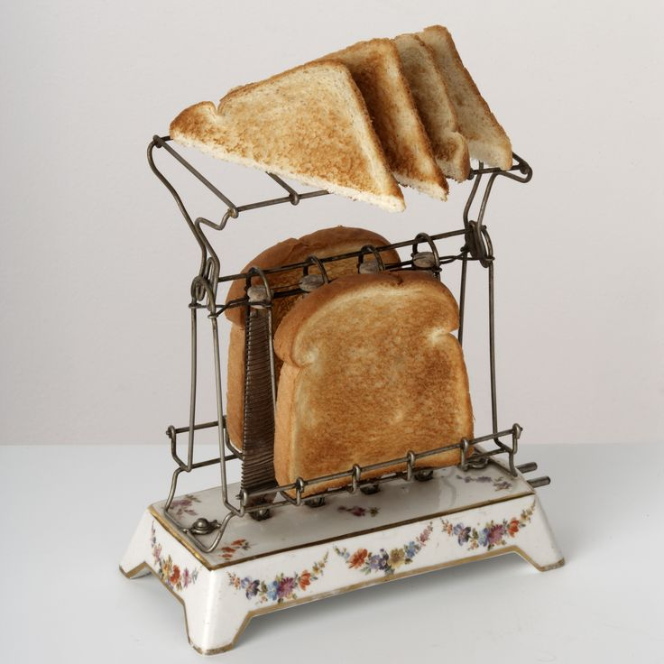 Antique Electrical Toaster, circa 1910, consisting of electrical heating coils surrounded by wire baskets for holding the bread. Bread slices needed to be turned by hand.