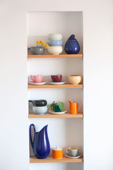 bathroom shelving, I really think I wouldn't store teapots and teacups in my bathroom, but this is a neat idea for shelving.