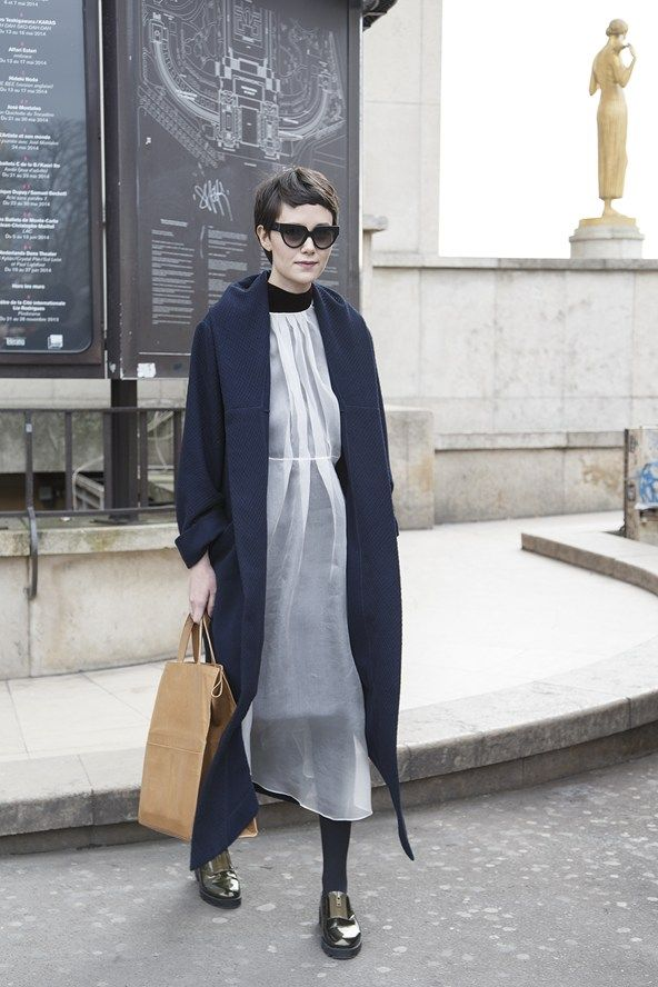 Prada sunglasses with a Mechanical Piano coat and dress, Cheap Monday shoes, and a Maison Martin Margiela bag.
