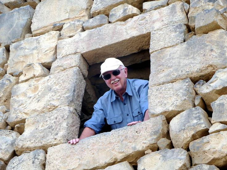 David Stanley peers through a window at the old Roman fort of Qasr Al-Azraq, 100 kilometers east of Amman, Jordan. In 1917 during the Great Arab Revolt, Lawrence of Arabia had his office in this room above the gatehouse.