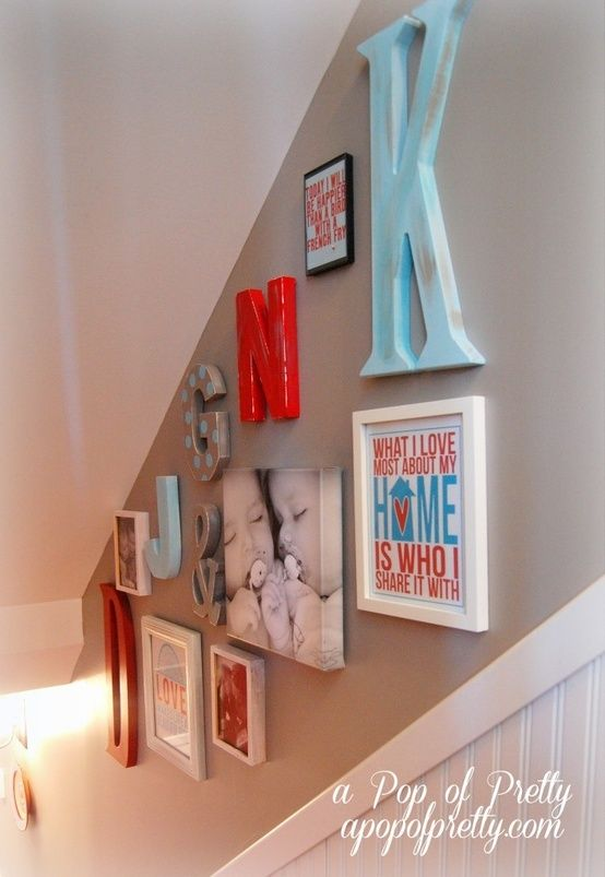 stairway gallery... cute. Love the pops of color.