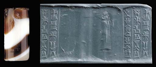 Old Babylonian cylinder seal, banded agate, 1683-1647 B.C.   With a single figure of a goddess in a long fringed robe, standing with both arms raised,  three line inscription in Babylonian cuneiform naming the owner Gimil-Marduk, son of Sîn-ellassu, servant of Ammi-ditana, 2.9 cm long. Private collection