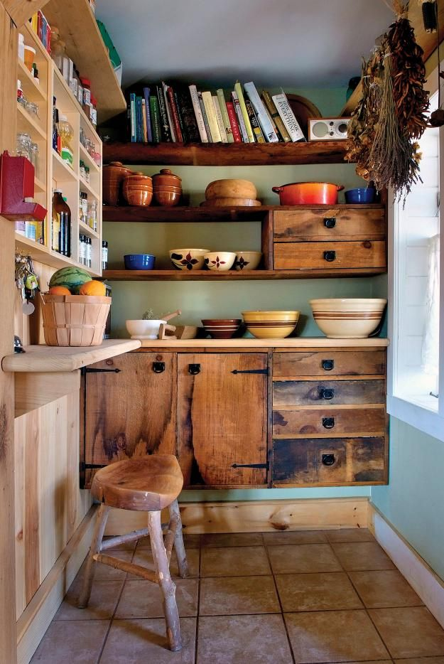 Very cosy pantry. Cabinets are made of salvaged wood.