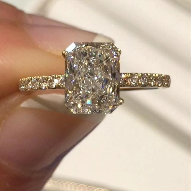 The perfect yellow gold and diamond details with this amazing radiant cut radian…