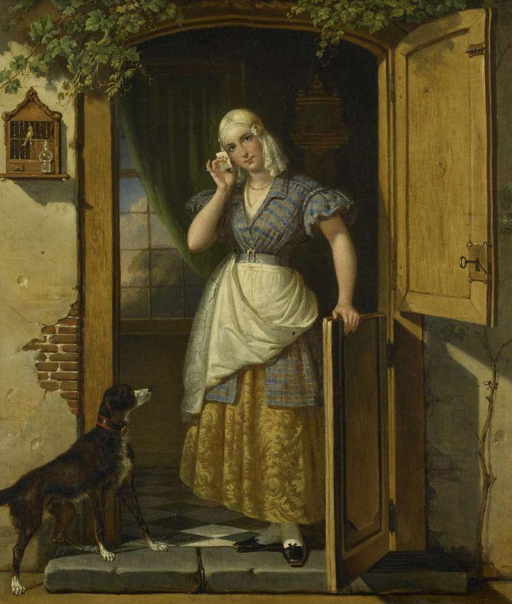 Johannes Hendrik van West | Love Note, Johannes Hendrik van West, 1838 | Het minnebriefje. Een jonge vrouw staande in de deur van een een huis. Zij houdt in de rechterhand een brief bij haar hoofd, de linkerhand rust op de onderdeur. Links bij de drempel staat een hond, naast de deur hangt een vogelkooi. Achter de vrouw hangt aan de muur een klok.