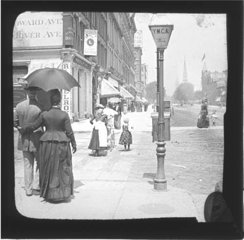 Vintage photo of couple walking down Woodward Ave., in Detroit, Michigan