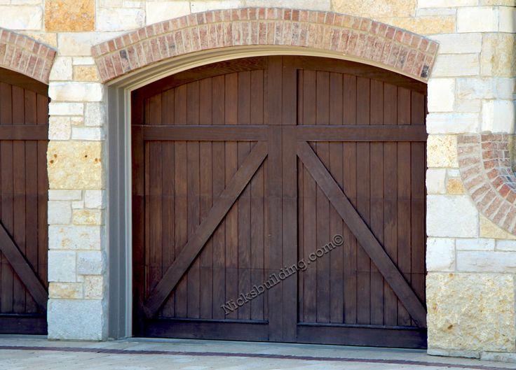 Wood garage doors arched top garage doors alaskan ceder for Wood front doors and garage doors