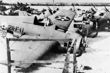 Destroyed F4F Wildcats on Wake Island, December 1941.-During their fifteen-day defense, the garrison at Wake Island sank four Japanese warships and severely damaged a fifth. In addition, as many as 21 Japanese aircraft were downed along with a total of around 820 killed and approximately 300 wounded. American losses numbered 12 aircraft, 119 killed, and 50 wounded