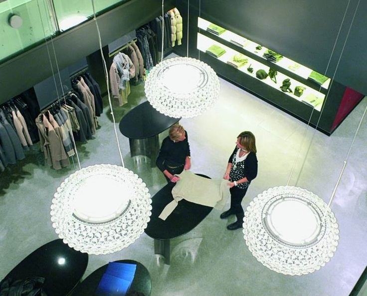 It is a luxurious suspension lamp comprising of transparent globes made of polymethylmetacrylate. The shade of white matt finish glass offers direct upward and downward projection of light, along with the diffusion throughout the space. It is a great choice for both residential and commercial purposes.