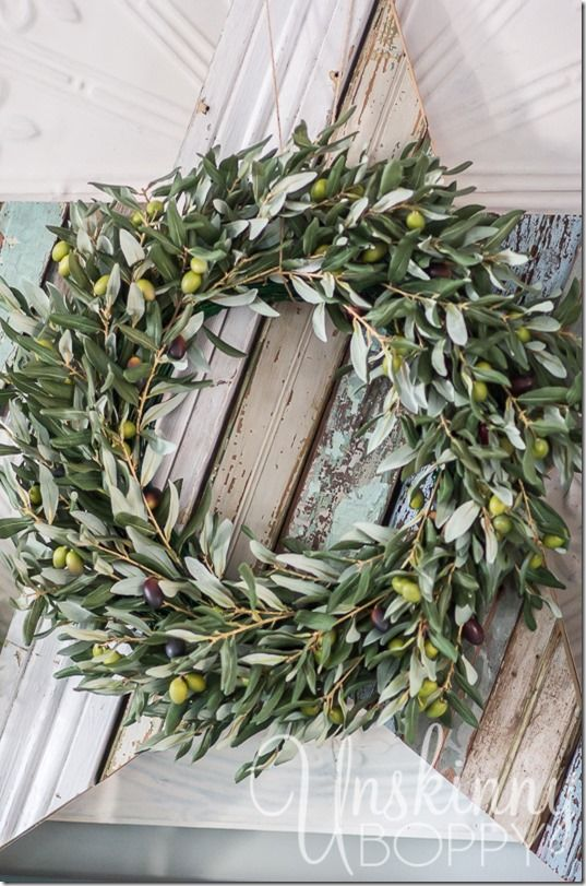 Layer our Olive Branch Wreath with a rustic wooden star for an extra festive look. Loving this idea from Beth!