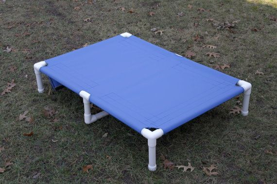 Dog bed. Extra large custom made pvc frame dog cots. will not rust. 13 canvas colors. 38x55x10 Elevated great dane dog beds. Dog cot made with
