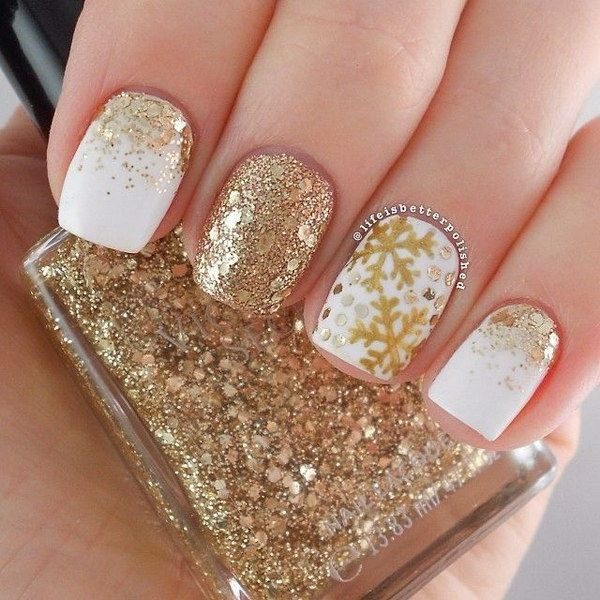 White and Gold Snowflake Nail Design.