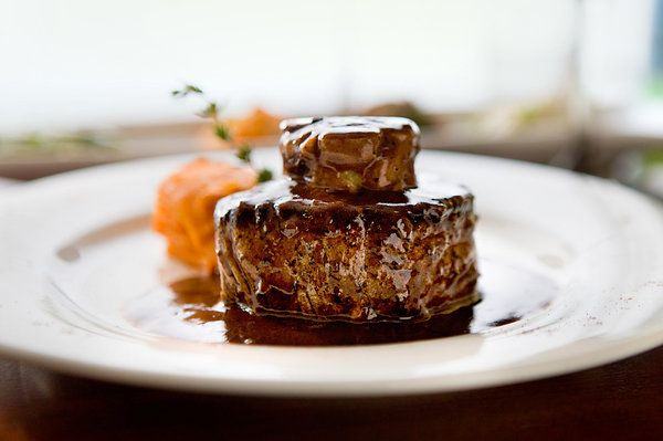 "NYT Cooking: If you want a phrase that summons all the voluptuous pleasure of haute cuisine in its heyday, ""tournedos Rossini"" does the trick. As a culinary undertaking, they are simultaneously simple and sybaritic. Toast two buttered spheres of bread. Top them with warm-from-the-pan filets mignons. Crown them with a slice of hot foie gras. Then anoint these little monuments of luxury wi..."