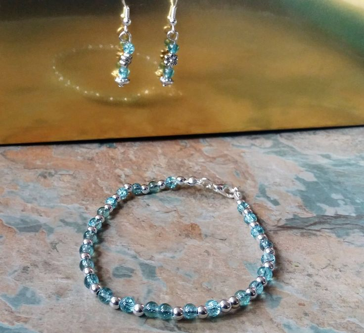 Blue crackled glass and silver bead bracelet with matching earrings set by SpryHandcrafted on Etsy
