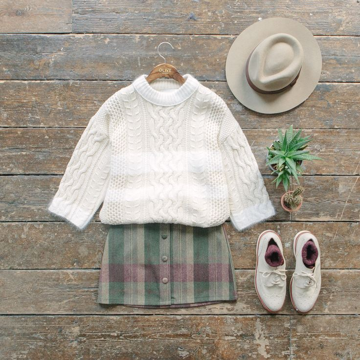 Outfits for slow living. Button front check skirt and block colour mini knit jumper online now. www.oliveclothing.com