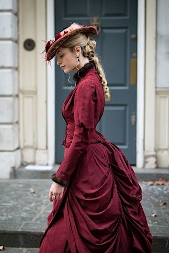 Victorian Walking Dress - A historically accurate victorian era daytime walking dress with bustle; what an upper class Victorian lady would wear for day. This wine/maroon/burgundy/red colored bodice has a matching skirt with a bustle in the back. Feathered hat and fur trimmed collar and sleeves complete the luxe look. - For costume tutorials, clothing guide, fashion inspiration photo gallery, calendar of Steampunk events, & more, visit SteampunkFashionGuide.com