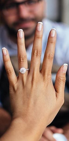 Love how dazzling this halo diamond engagement ring is.