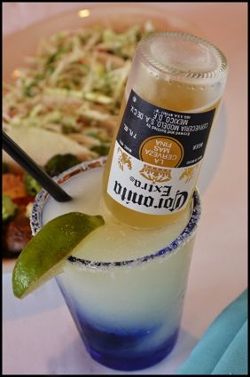The Exhausted Mom: Thirsty Thursday ~ The Corona-Rita    Corona-Ritas    In a pitcher, combine equal parts (use the limeade can to measure):    Frozen limeade concentrate  water  Sprite  tequila    add one Corona    Stir, serve, and be careful, 'cause these guys go down waaaay too easy!