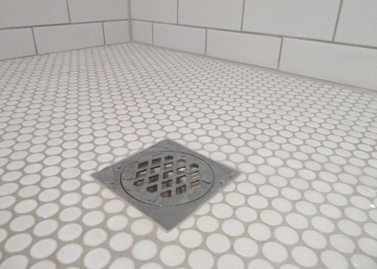 White Penny Rounds Shower Pan With White Subway Tiles Bath
